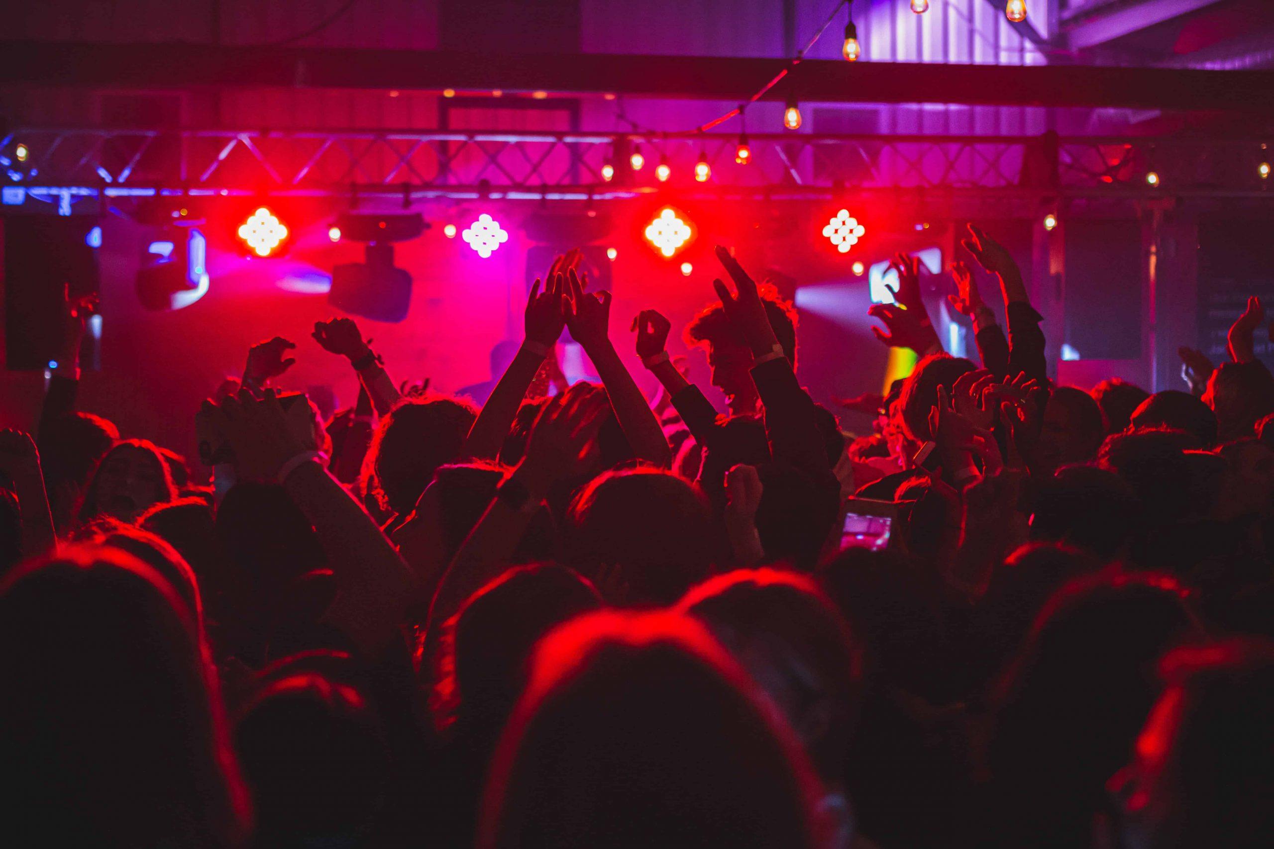Nightclub crowd red light Long Truong