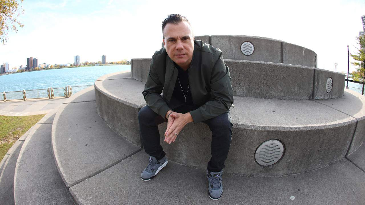 DJ Godfather sitting concrete terrace park