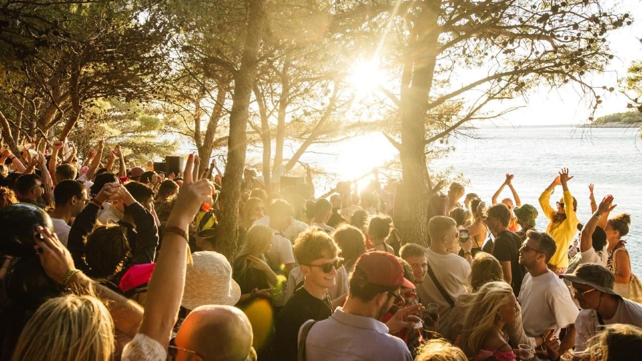 Love International Festival sun trees crowd