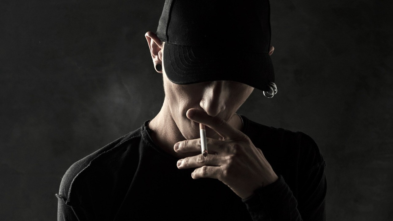 Gotshell smoking a cigarette