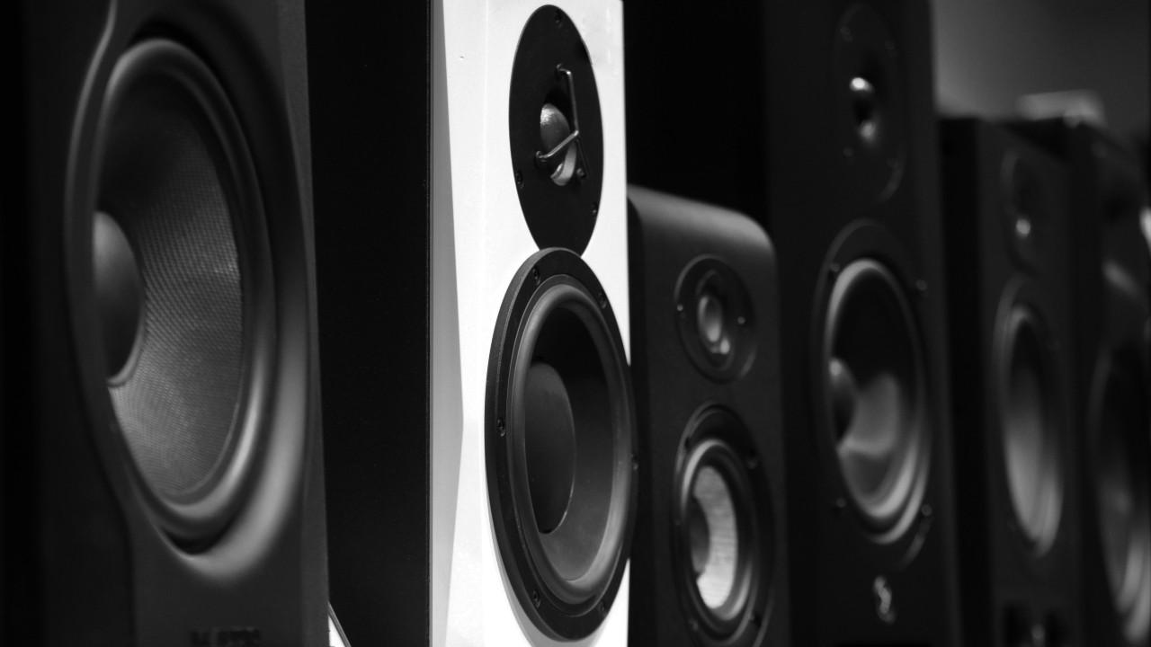 Row of speakers by Sandy Kawadkar