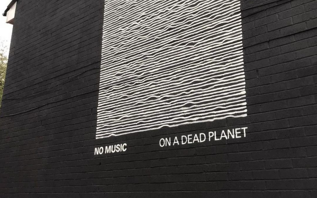 Manchester Climate Change Mural Inspired by Famous Joy Division Album Artwork