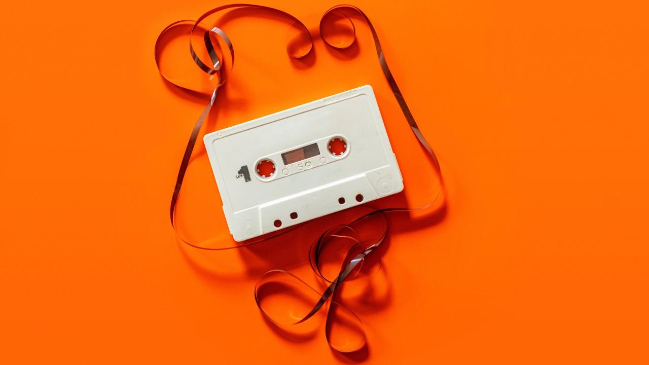 Cassette tape orange background David Schludi
